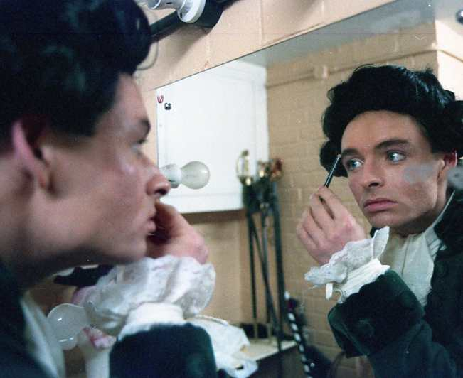 Simon Bolton applies stage makeup