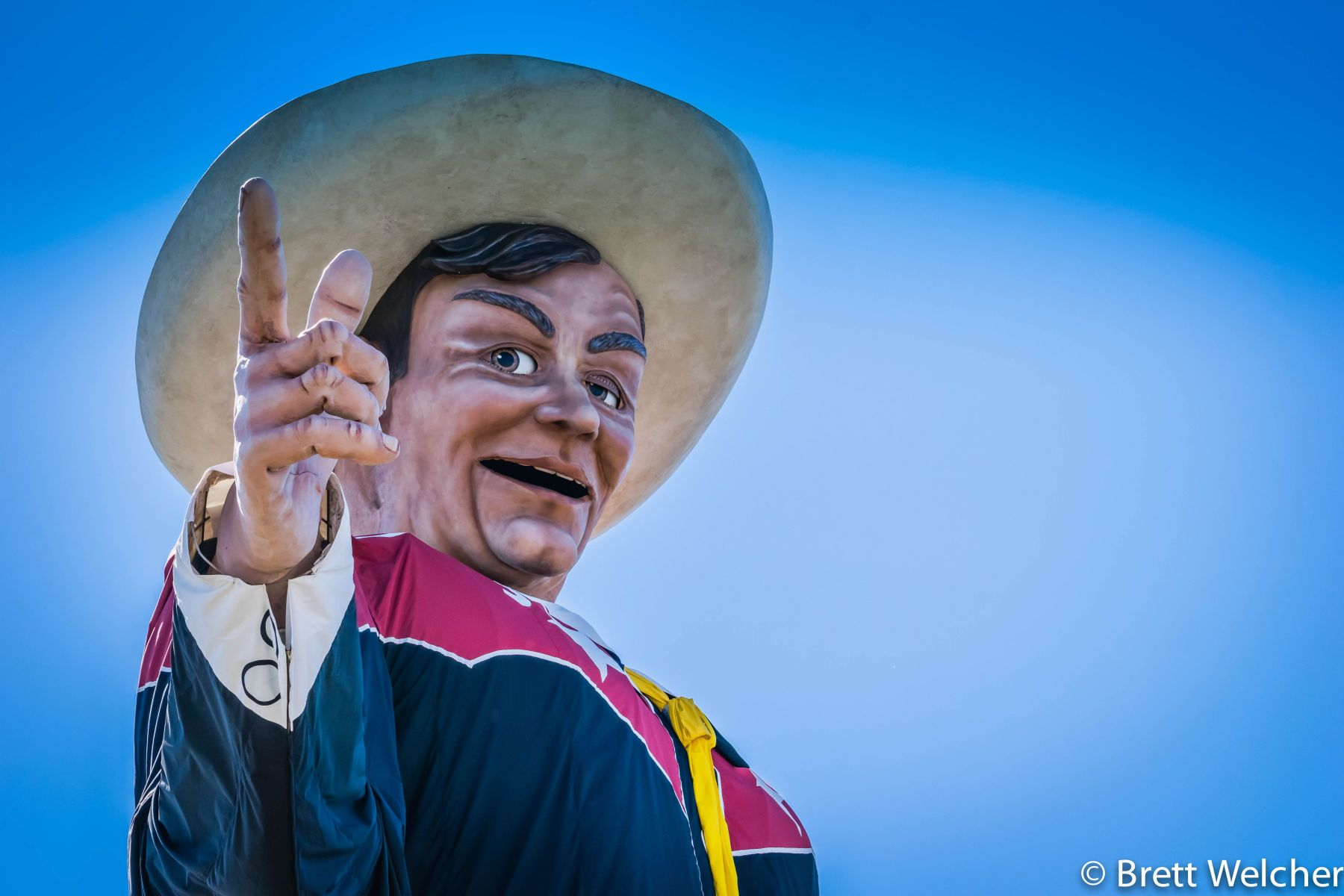 Big Tex is a 55-foot tall statue and marketing icon of the State Fair of Texas. Visitors from near and far travel annually to admire the famous statue and his 95 gallon hat.Big Tex's 1952 State Fair debut was auspicious. Speechless that first year, a littl