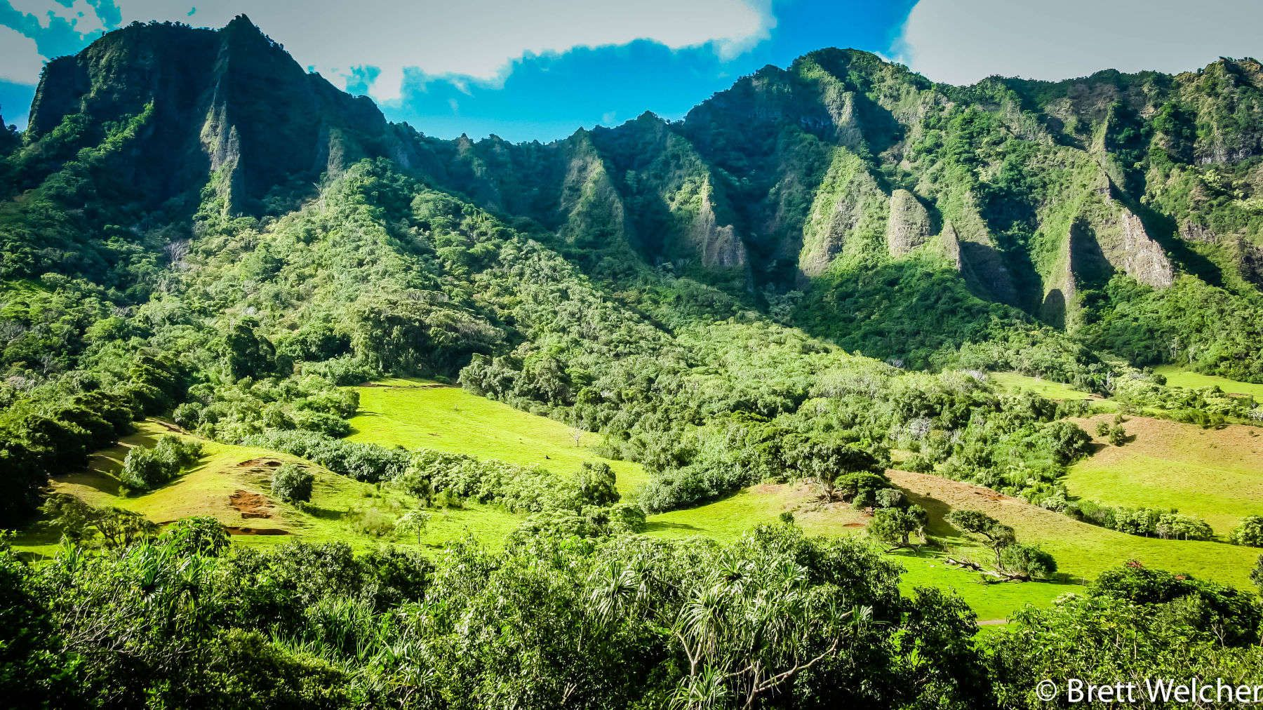 "Kualoa Ranch is 4,000 acres of beauty, history and adventure! It is most well known for serving as the filming location for the blockbuster ""Jurassic Park"" and the ABC hit series ""LOST."""