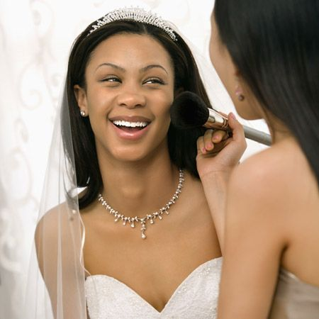 Make-up being applied to bride