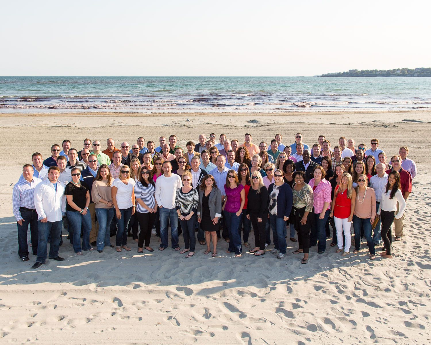 Corporate clients enjoy an afternoon at the beach in Newport.