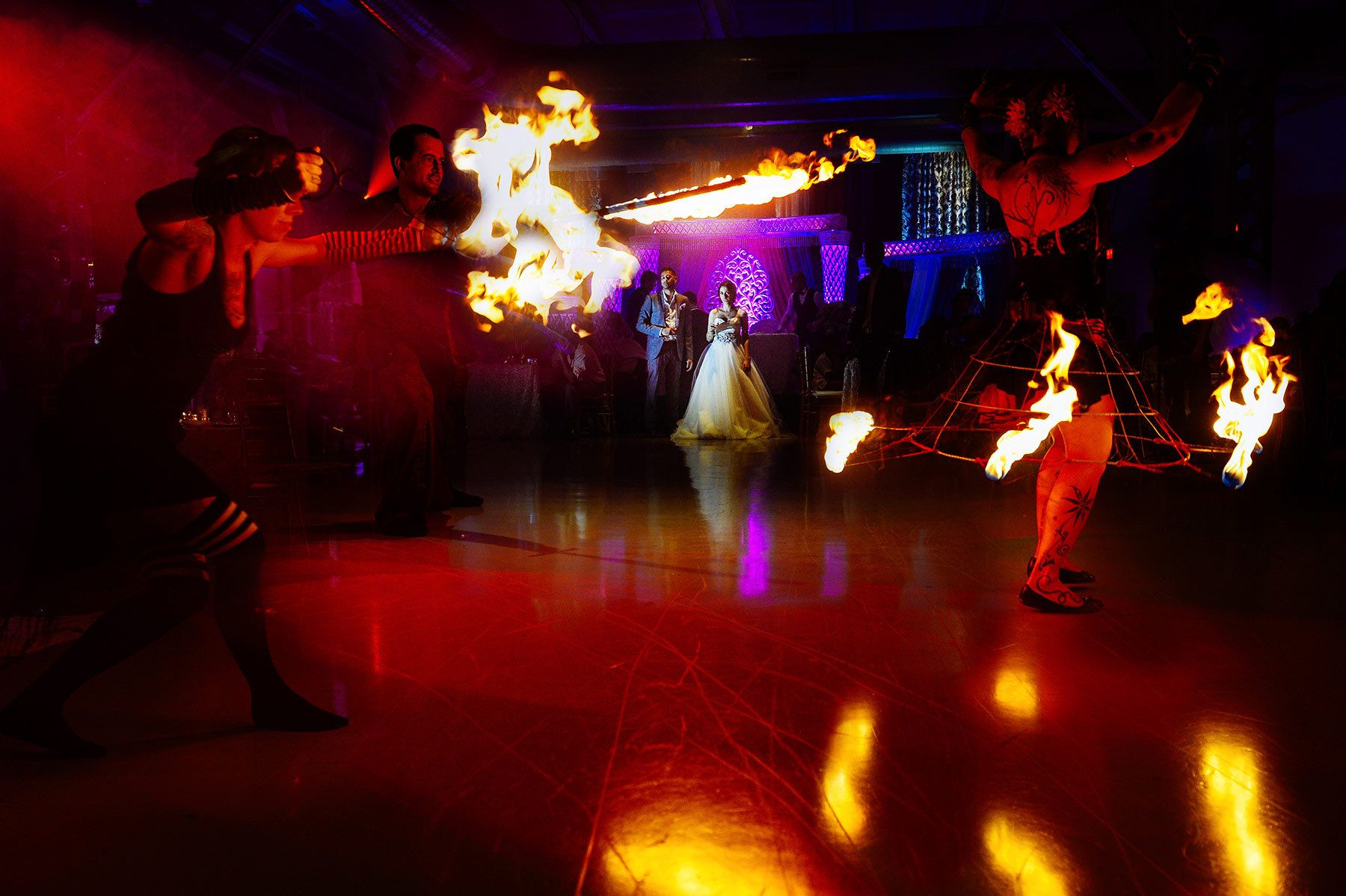 Montreal wedding photographer, the newlyweds watching the fire show