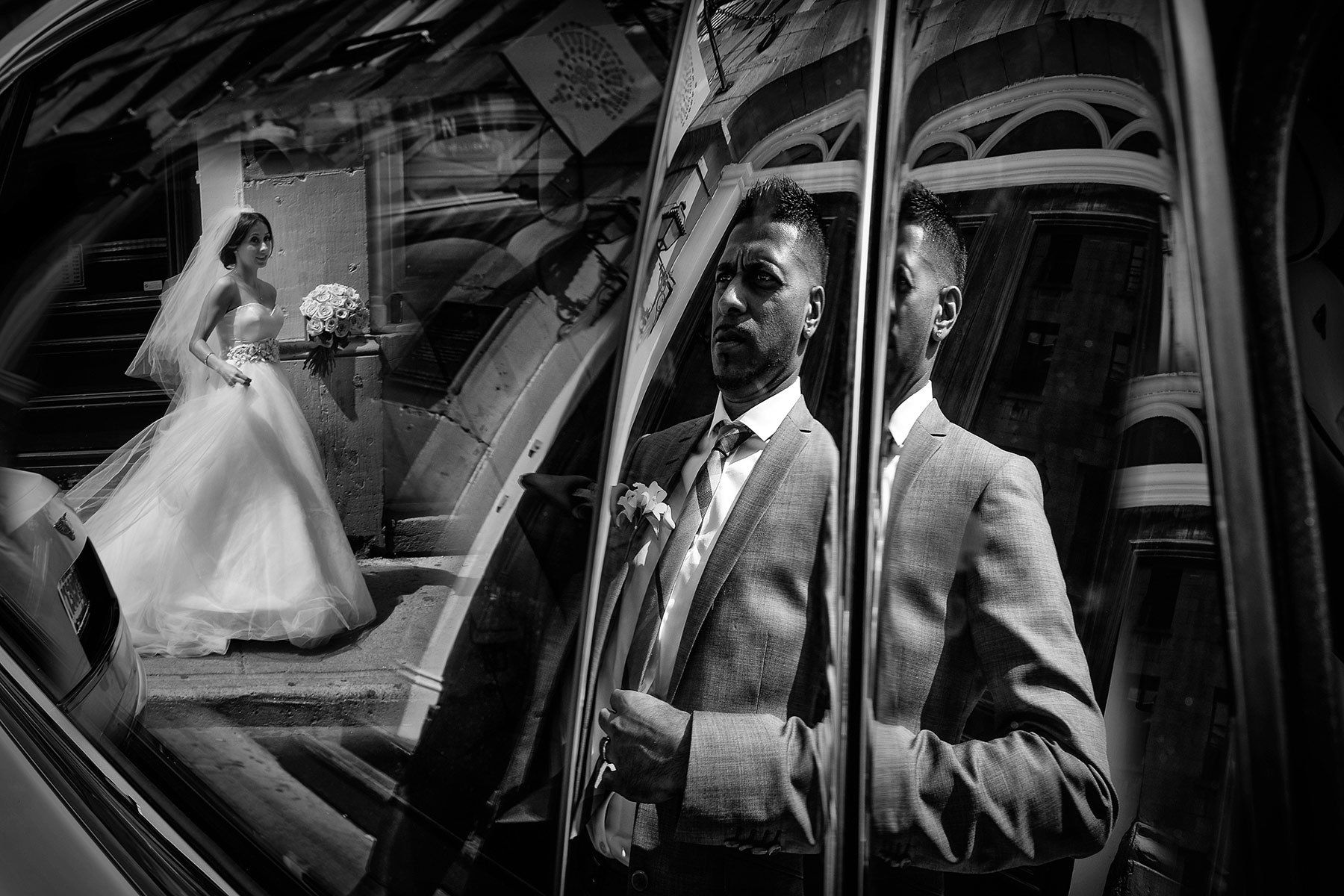 Montreal wedding photographer, reflection of the bride and groom