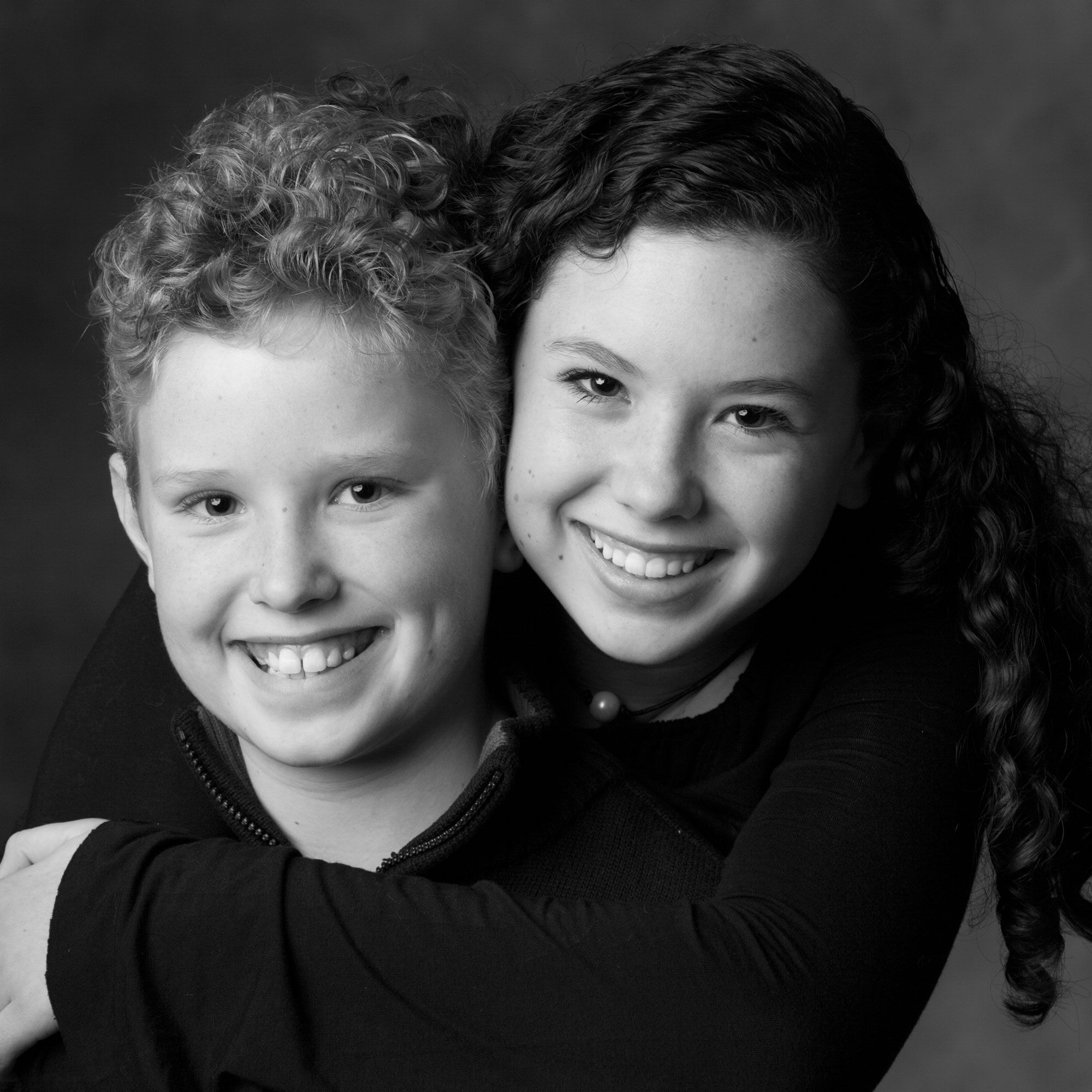 Black and white portrait of brother and sister. Family photograph by Donald Chambers.
