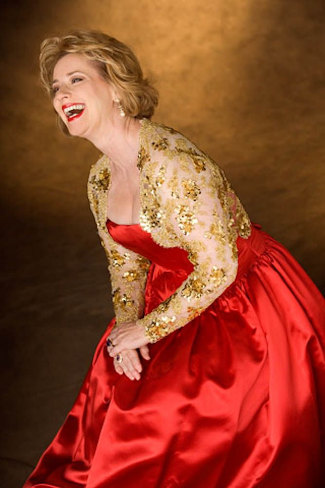 Beth in a red dress. Color photograph by Donald Chambers.