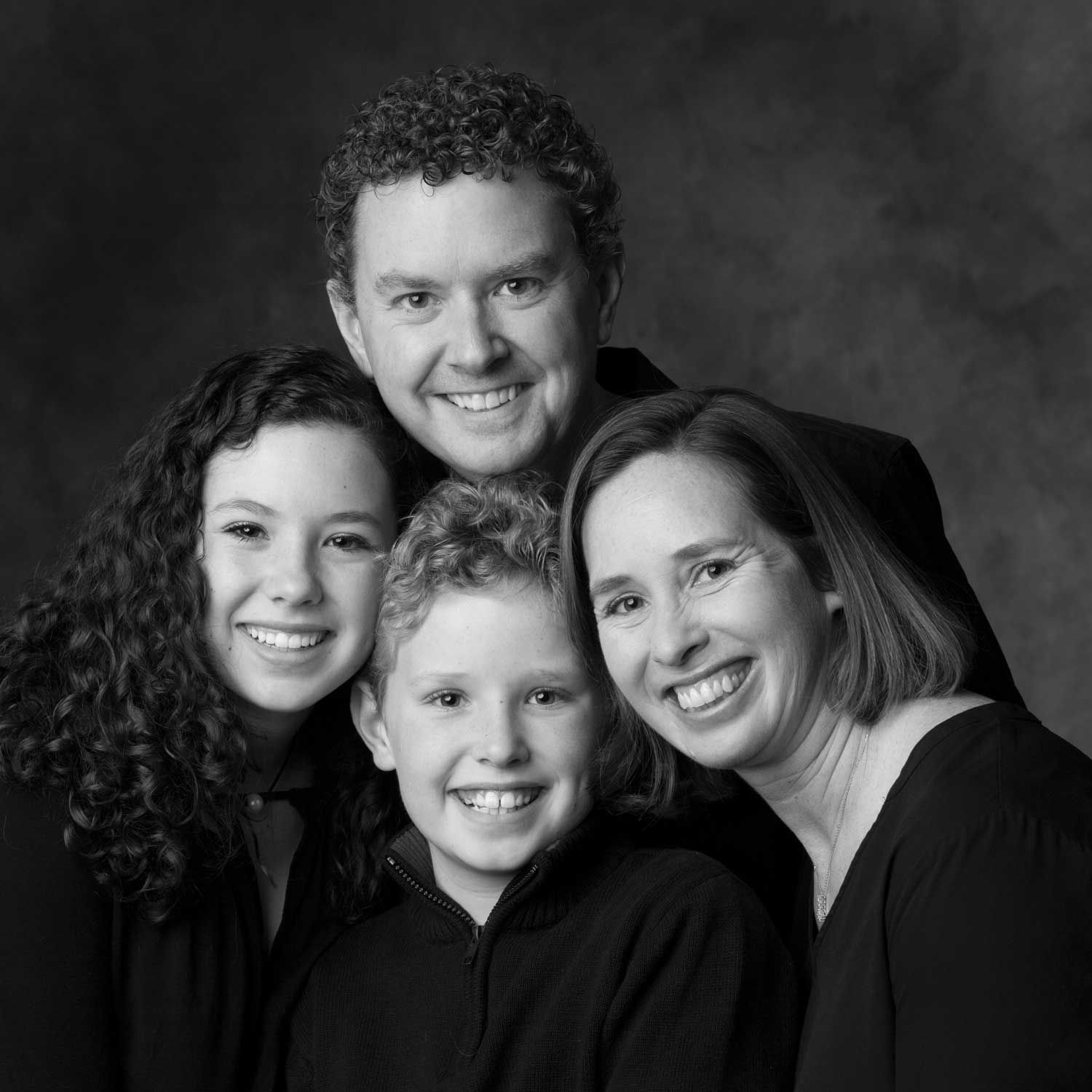 Black and white family portrait. Photograph by Donald Chambers.