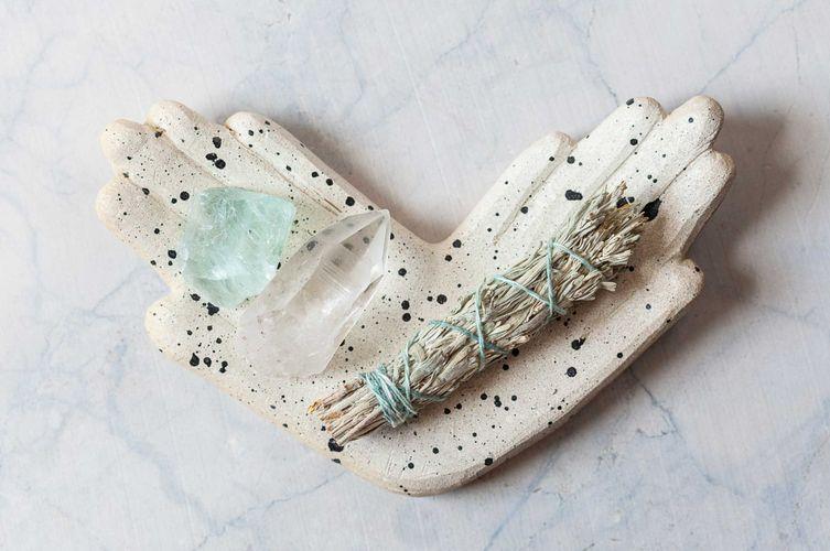 crystals-in-prayer-hands.jpg