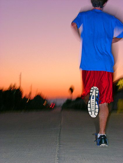 Male runner in Diesel shoes at sunset