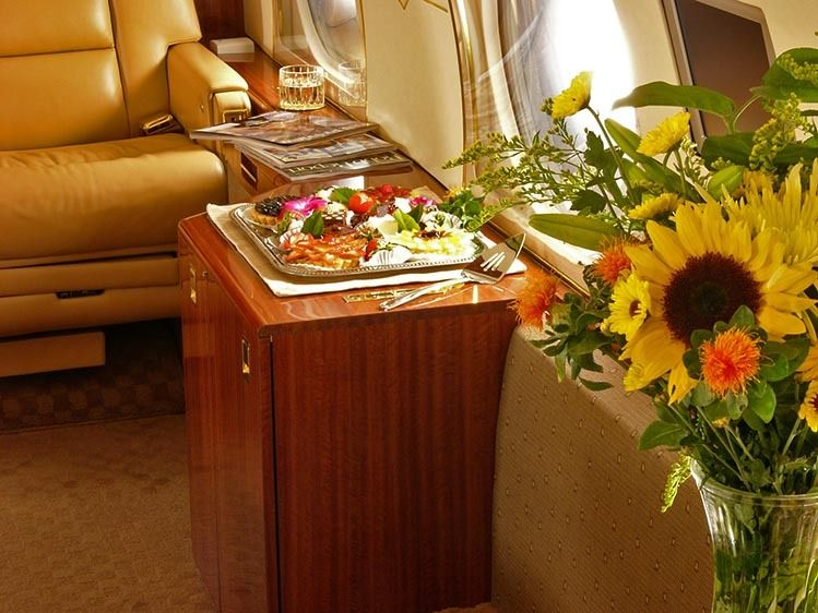 Gulfstream jet interior detail with food and flowers