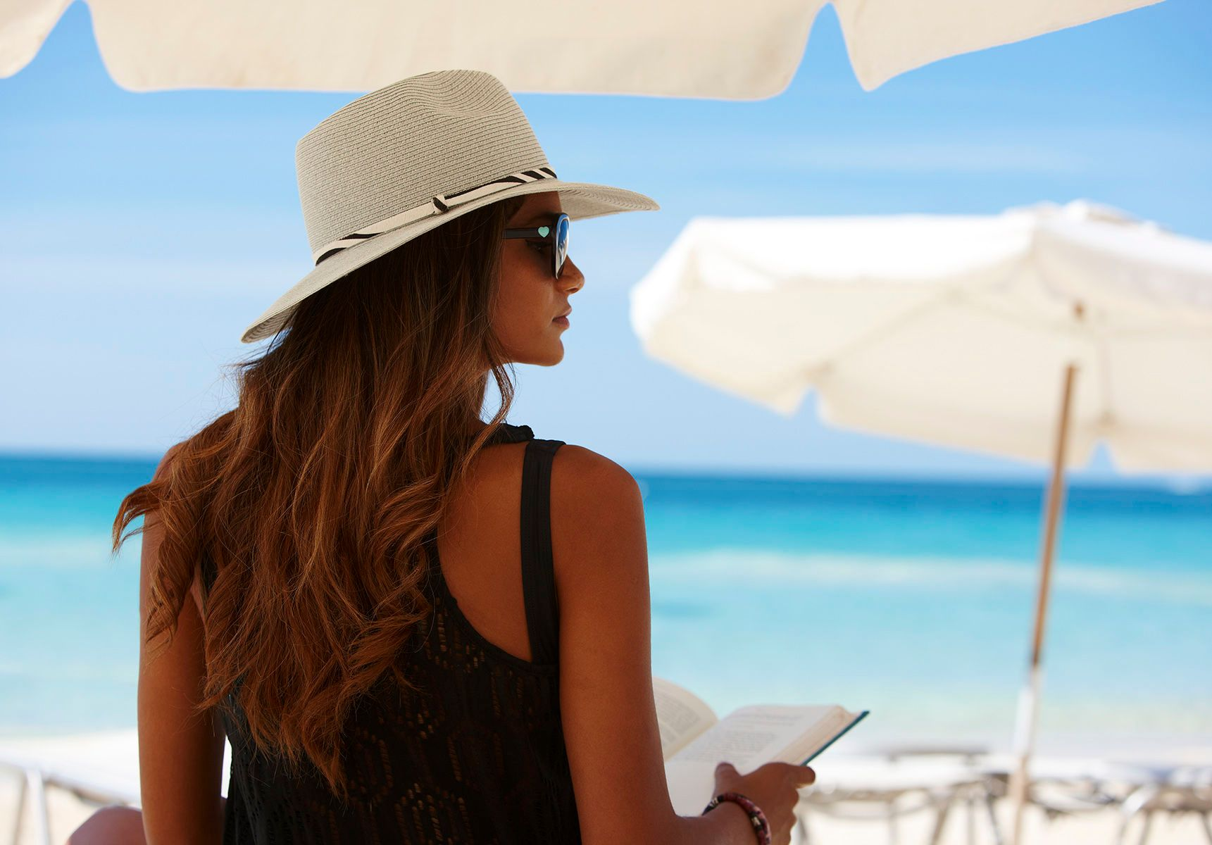 Resort Lounging on Beach With Book Grand Cayman Marriott