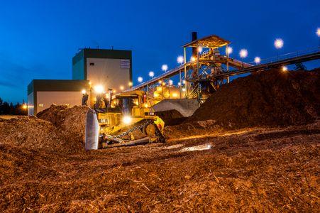 Bulldozer Pushing Wood Chips Used for Energy
