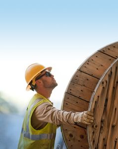 Lineman With Spool of Power Line