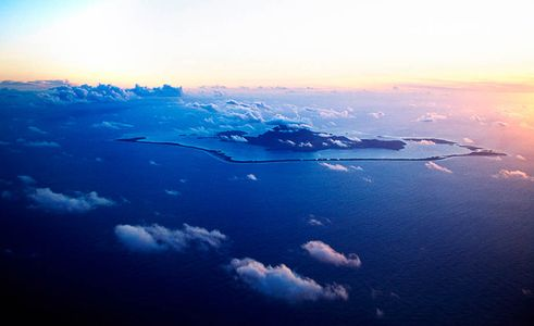 View above Bora Bora as the sunsets to the west, French Polynesia, Islands Magazine
