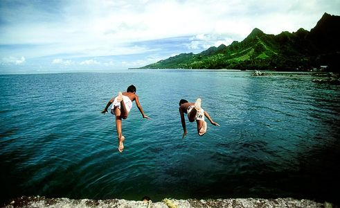 Boys Diving off the dock , Haapiti, Moorea, Islands Magazine