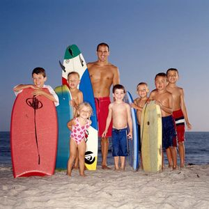Kelly Slater 9 Time World Champion Surfer with Beach Kids, Outside Magazine
