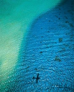 Aerial over the reef Rangiroa, Islands Magazine