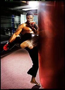 Michael jai White kicking a heavy bag
