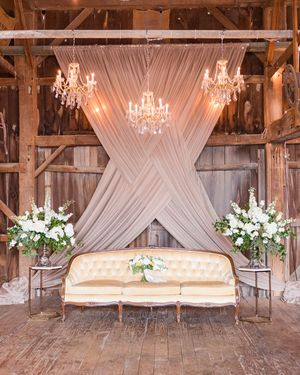 Backdrop and chandelier lighting for barn wedding