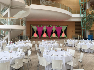 DBJ Best Places to Work stage backdrop pink, green and black spanl.JPG