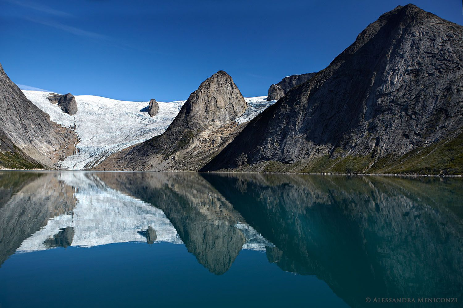 A receding glacier and pinnacle peaks in Tasermiut Fjord, South Greenland.