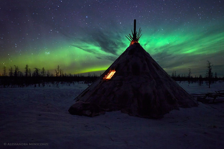 Aurora borealis and Nenet chumon he Arctic tundra in Yamal, Siberia