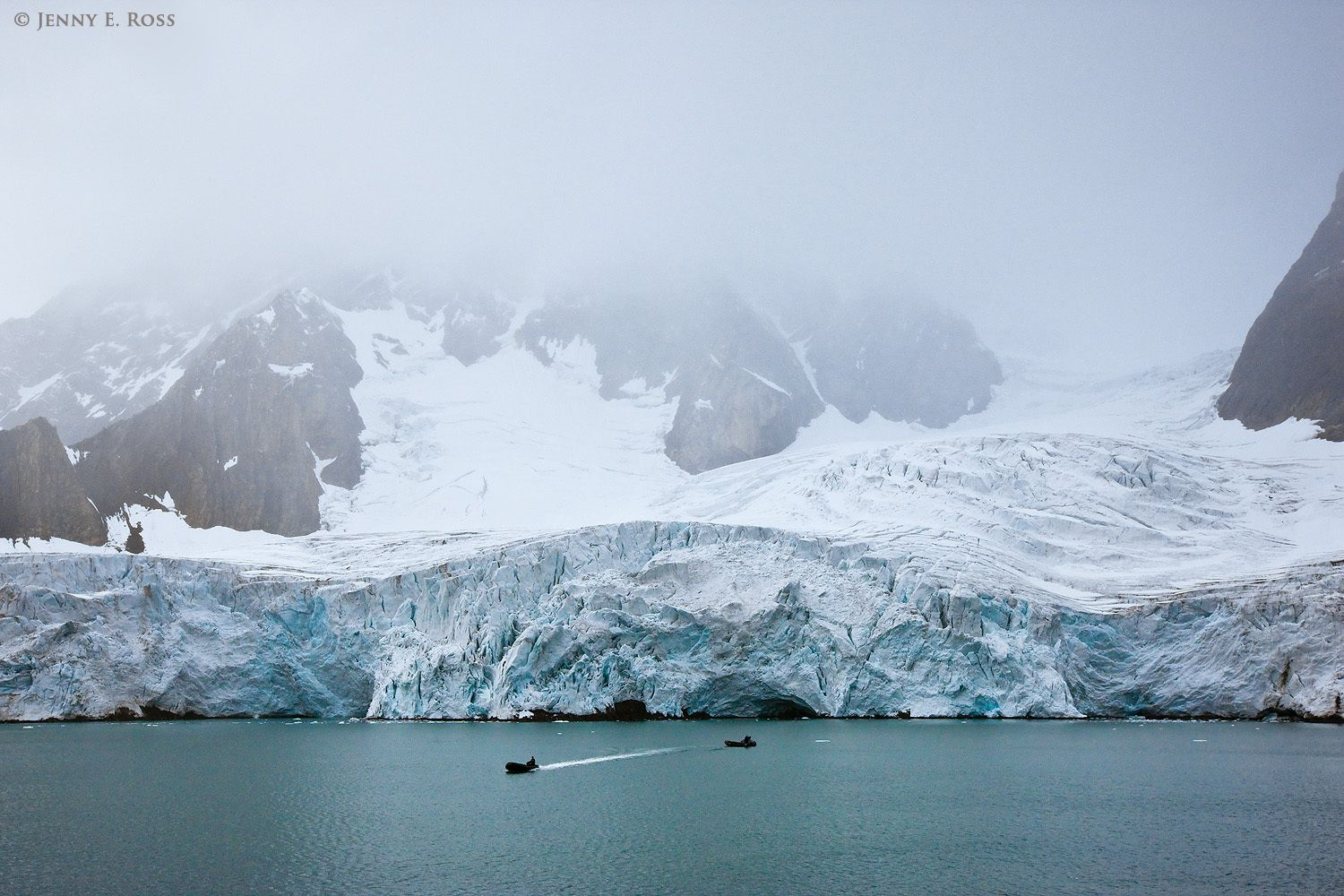 Ecotourism boats (Zodiacs) at Samarinbreen Glacier on Spitsbergen, in the Svalbard Archipelago, Norway.