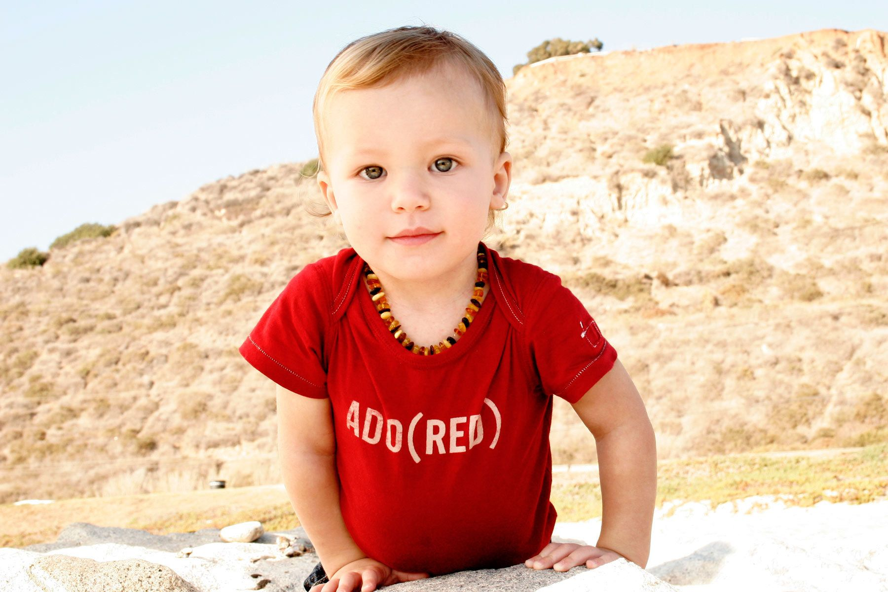 Baby in red Gap T-shirt for fashion lifestyle photo shoot.