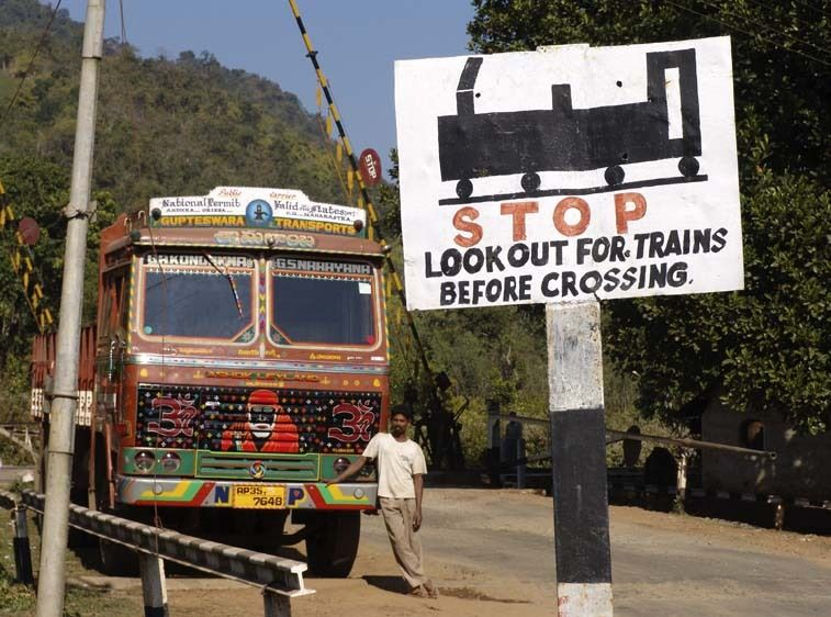 Railroad crossing sign, rural India
