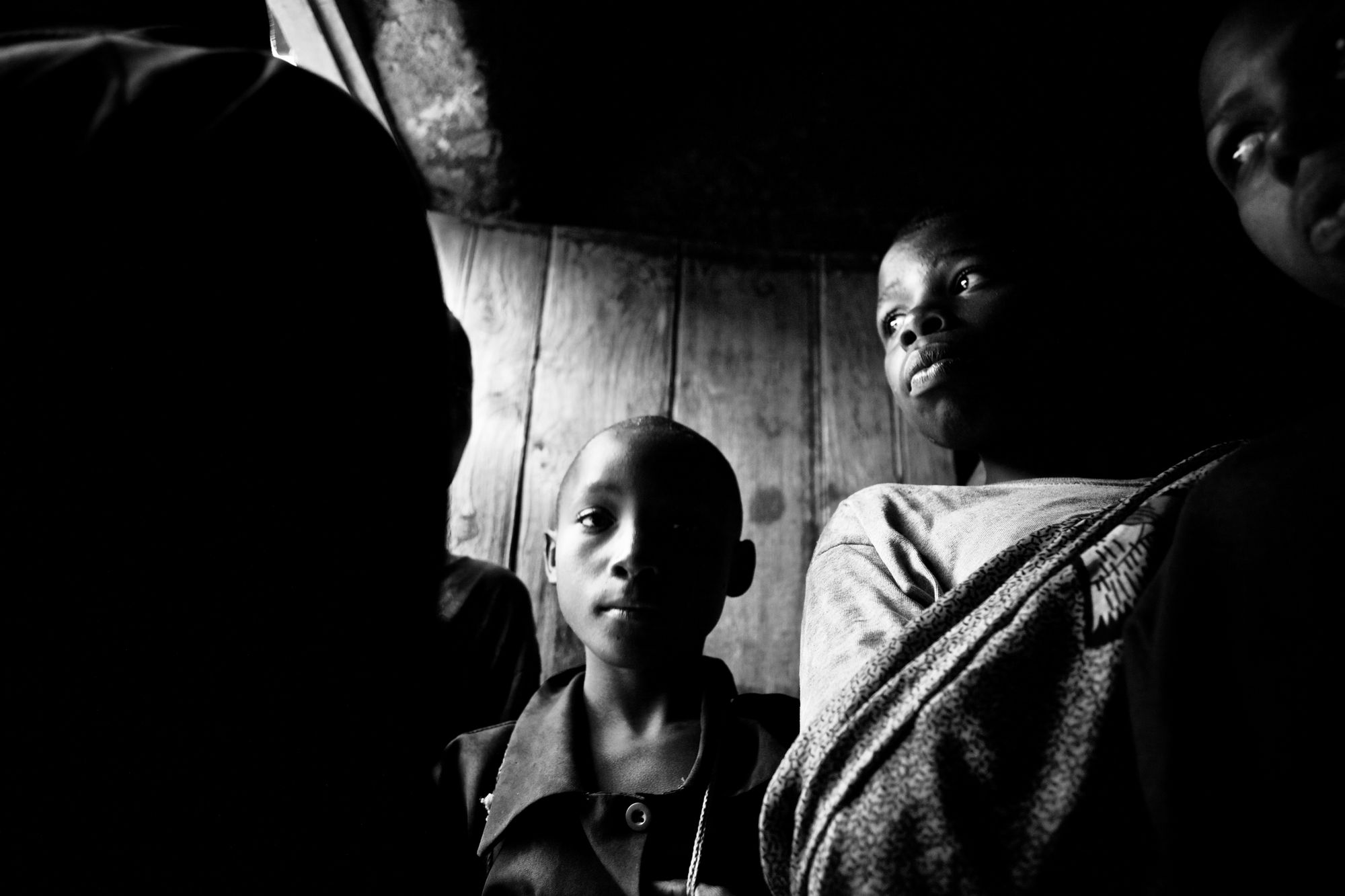 Rwandan children waiting out a storm