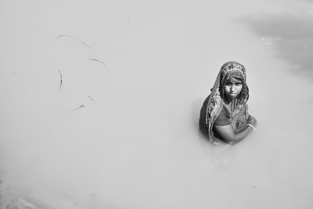 Indian woman in a small pond