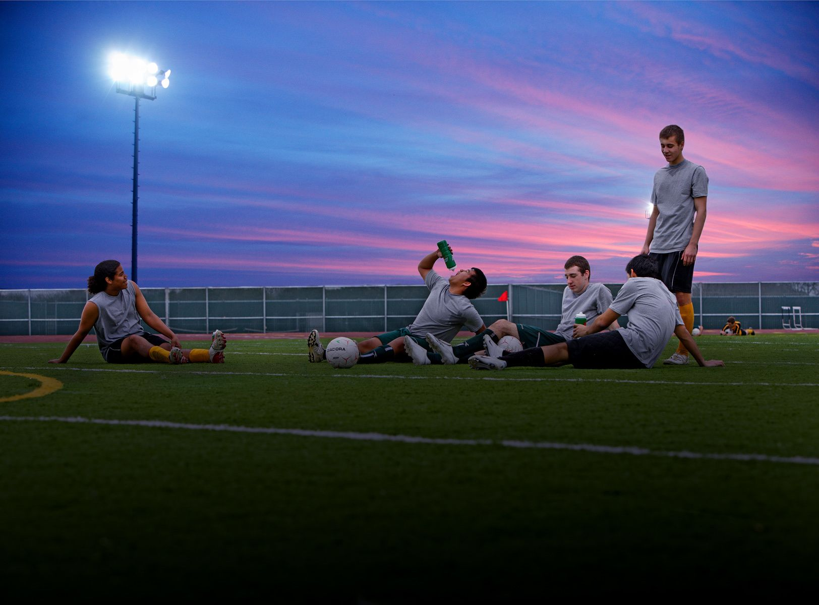 Soccer Players Sunset