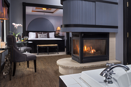 Guestroom with a fireplace and jacuzzi tub.jpg
