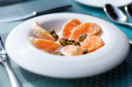 Sliced oranges over yogurt breakfast - English Meadows Inn.jpg