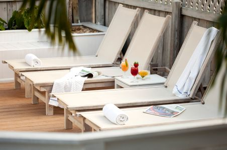 Reclining chairs on outside deck at a Key West Inn.jpg
