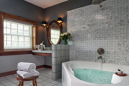 Interior photograph of a sink and jacuzzi tub.jpg