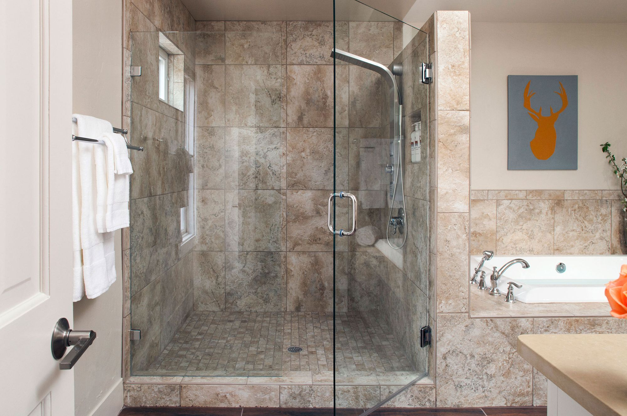 Interior photograph of a glass door shower and tub.jpg