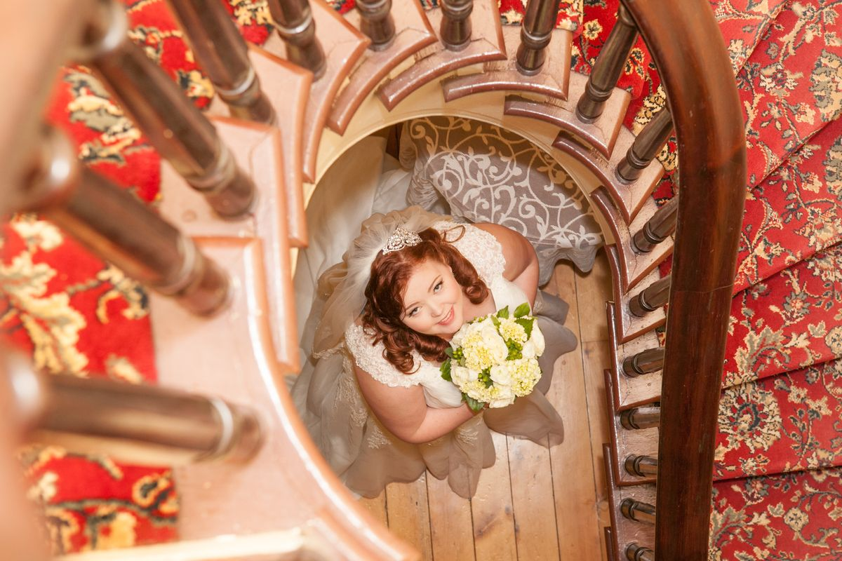 Beautiful bride at Sprial Stairs.