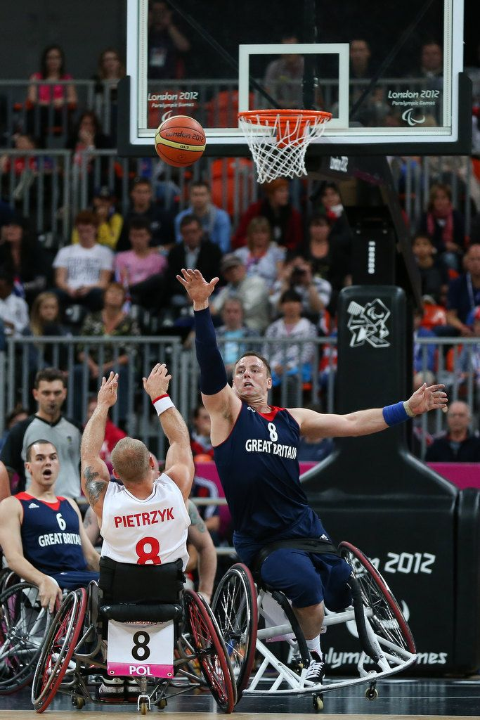 Simon Munn of GBR attempts to block the shot of Krzysztof Pietrzyk of POL