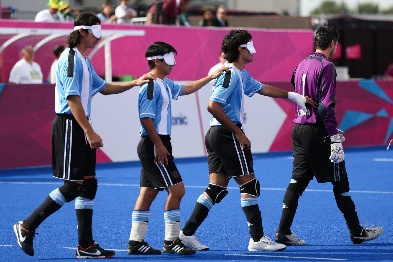 The Argentina team lead each other on to the field