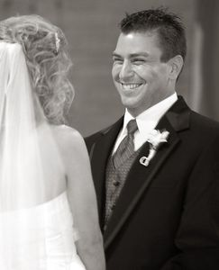 Groom grinning from ear to ear