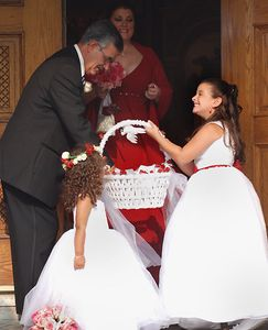 Flower girls greeting the guests