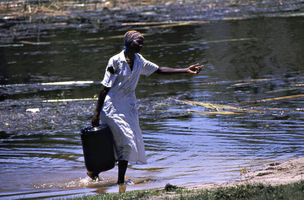 Local woman gathering river water
