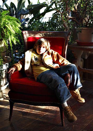 1Logan_in_red_chair.jpg
