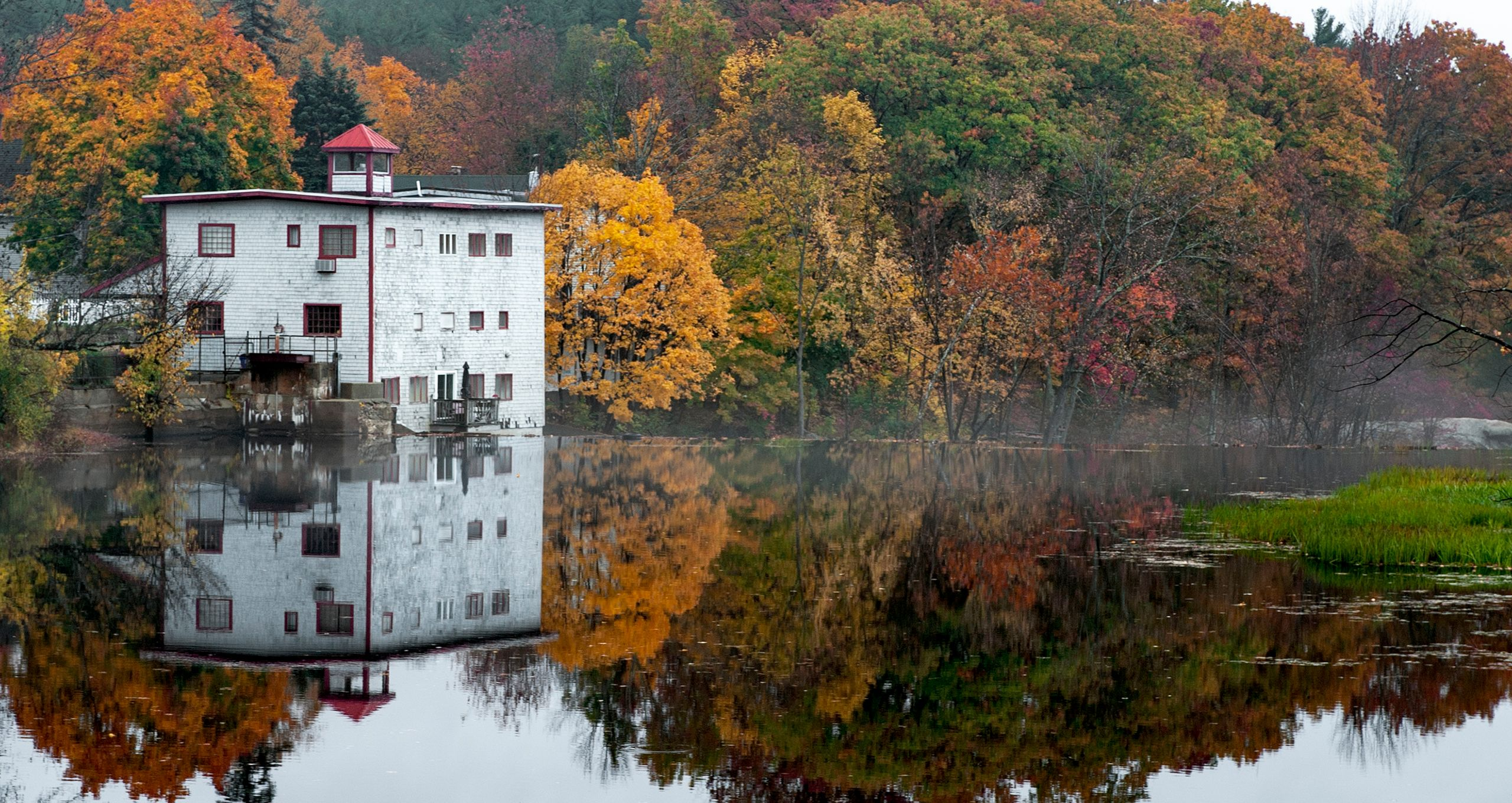 Building on Still Lake in Fall