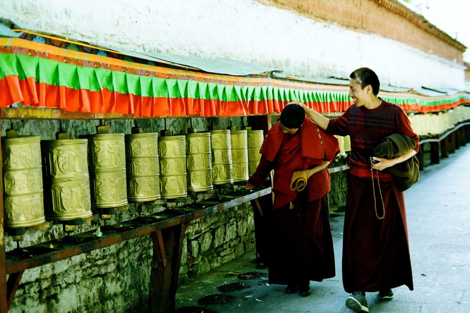 1monks_and_prayer_wheels_surrounding_potala_palace