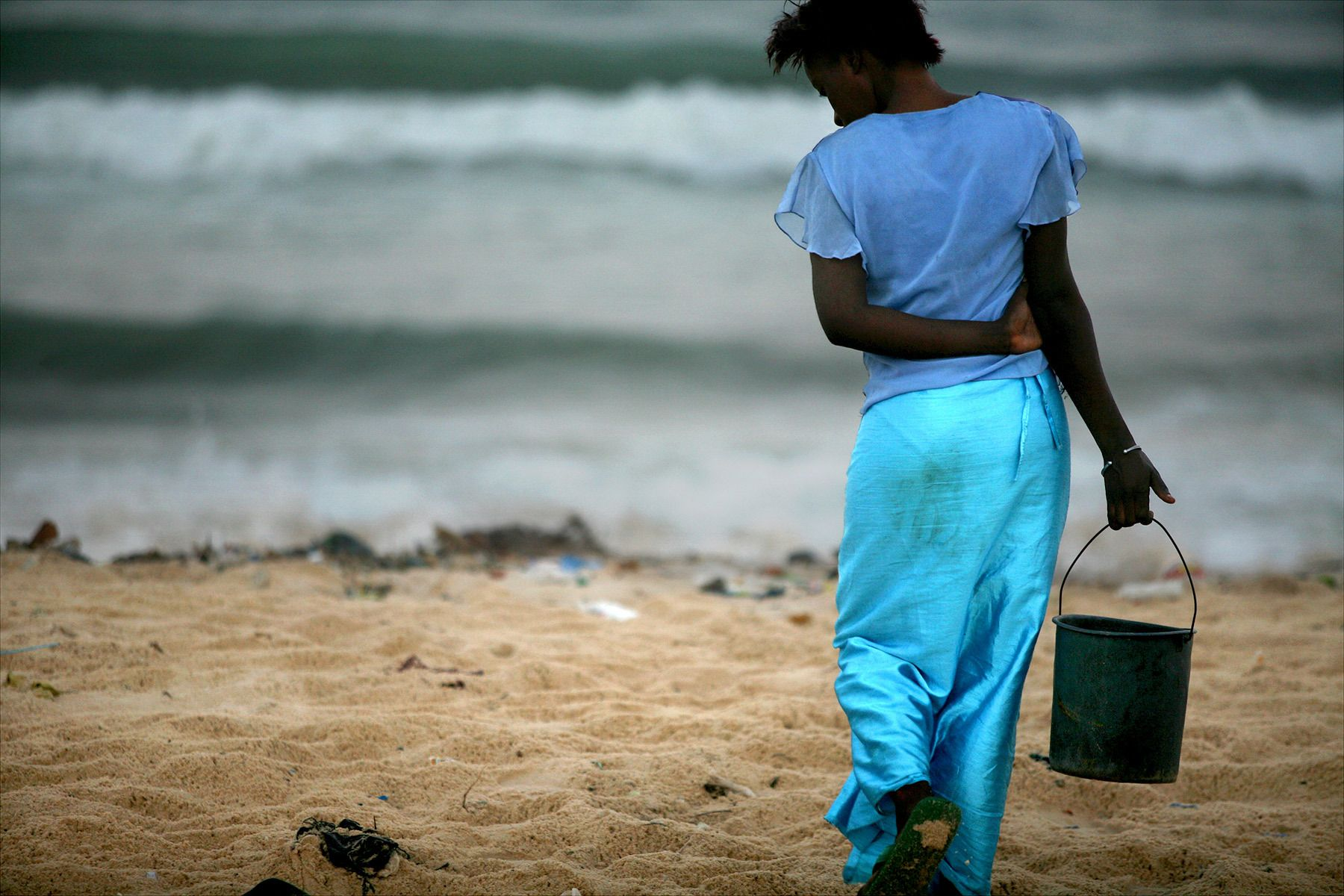 SENEGALESE GIRL IN TURQUOISE SKIRT