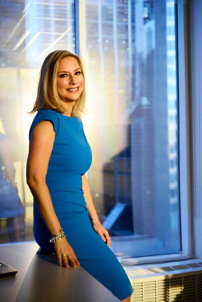 Corporate woman executive in blue dress photographed in downtown Chicago
