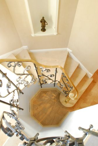 1staircase_ornate_banister_banister_metal_work_round_staircase_pandtremodeling.jpg