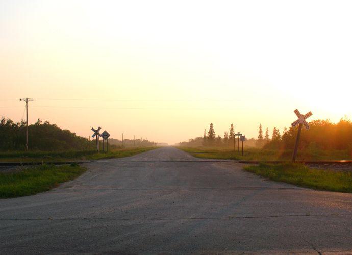 1travel_evening_railroad_crossing_minnesota_lonely_nancy_e_hill_photography.jpg