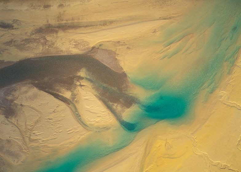 MELTWATER FLOWING OVER GOLDEN SAND AND SILT BARS, BAFFIN ISLANDS, 1994  BUY THIS PRINT